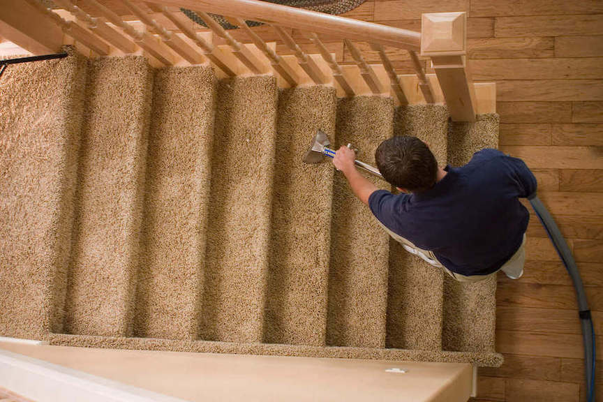 Chem-Dry technician cleaning carpeted stairs